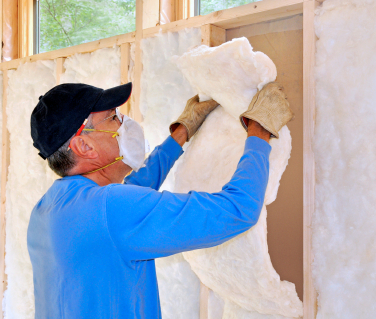 VeriTend-man-hanging-insulation and radiant barrier